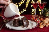 Cream on a christmas pudding — Stock Photo