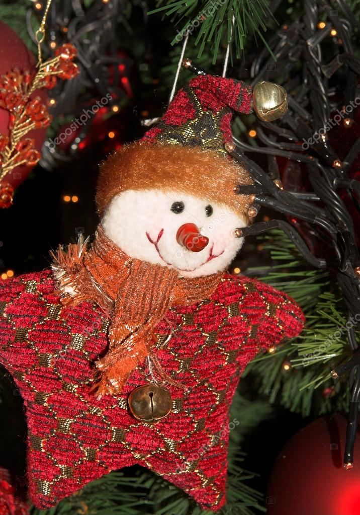 Christmas puppet decorating a christmas tree — Stock Photo #13566779