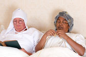 Retired couple in bed — Stock Photo