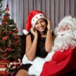 On santa's lap — Stock Photo