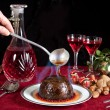 Christmas pudding flambe — Stock Photo