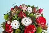 Flores y relojes — Foto de Stock