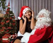 On santa's lap — Stock Photo