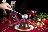 Christmas pudding flambe — Stock Photo