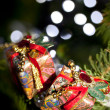 Two gifts in a christmas tree — Stock Photo