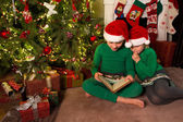 Reading christmas stories — Stock Photo
