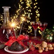 Christmas pudding and sparkling fire — Stock Photo #13831180