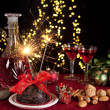 Christmas pudding and sparkling fire — Stock Photo