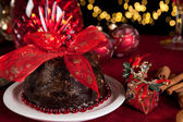 Christmas tree and plum pudding — Stock Photo