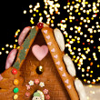 Christmas lights and gingerbread house - Stock Photo