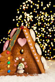 Christmas lights and gingerbread house — Stock Photo