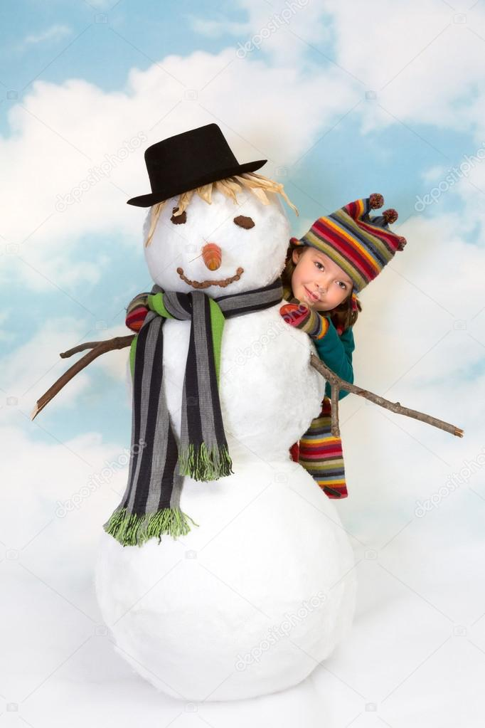Smiling little girl hiding behind her snowman — Stock Photo #13900077
