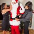 Santa getting dressed — Stock Photo