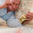 Checking alarm clock — Stock Photo