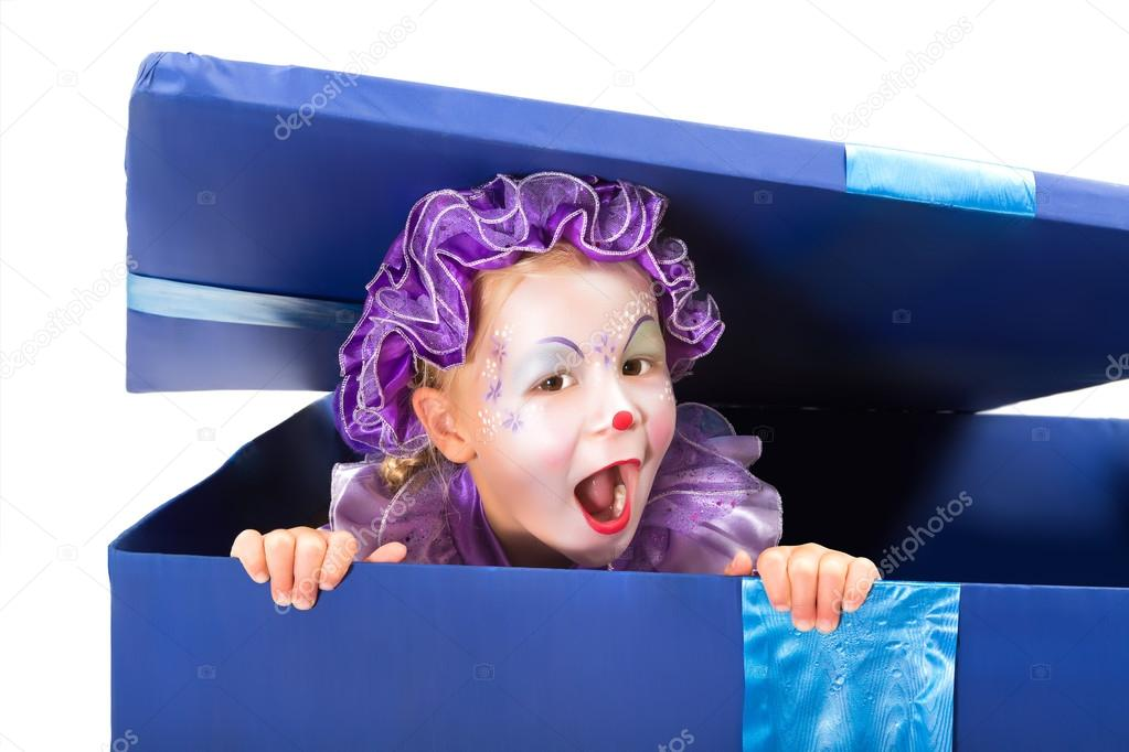 Little four year old popping out of a surprise box in clown disguise — Stock Photo #14137628