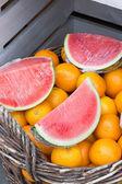 Watermelon and oranges — Stock Photo
