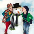 Kissing a snowman — Stock Photo