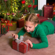 Opening christmas gifts — Stock Photo