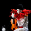 Pierrot with violin — Stock Photo