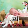 Stock Photo: Old toys and newborn baby
