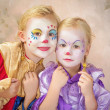 Stock Photo: Two clown girls painted