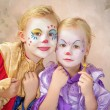 Two clown girls painted — Stock Photo