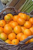 Fresh oranges in a basket — Stock Photo