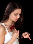 Rose pricking a finger — Stock Photo