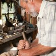 Stock Photo: Carving carpenter