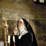 Nun at altar — Stock Photo