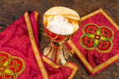 Hosts or wafers in chalice for communion — Stock Photo