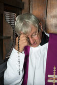 Confession box and priest — Stock Photo