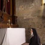 Kneeling in a chapel — Stock Photo