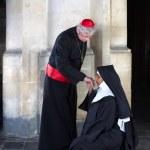 Nun kissing ring cardinal — Stock Photo