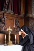Nun in chapel — Stock Photo