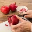 Royalty-Free Stock Photo: Cutting a pomegranate
