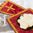 Stock Photo: Communion hosts or wafers and vestment