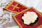Communion hosts or wafers and vestment — Stock Photo