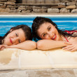 Swimming pool girl friends — Stock Photo