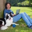 Dog and working girl — Stock Photo