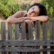 Lonely against a fence — Stock Photo