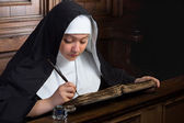 Vintage nun with book — Stock Photo