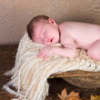 Baby in trench bowl — Stock Photo