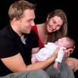 Family photo with newborn baby — Stockfoto