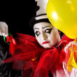 Clown with exploded balloons — Stockfoto