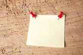 Pushpin notepad on board — Stock Photo