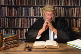 Judge with law books — Stock Photo