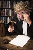 Judge looking through monocle — Stock Photo