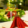 Christmas tree and dinner table — Stock Photo