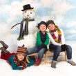 Posing around the snowman — Stock Photo